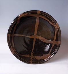 Pucker Gallery _ Obachi _ Large bowl, ca. 1950 _ black  with poured kaki decoration _ stoneware _ 5.5 x 23 x 23""