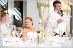 A look to the groom during the best man's speech at Deer Park Hall near Pershore