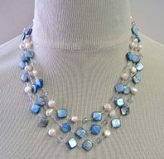 "Triple strand necklace in MOP 8mm, fwp 7-8mm and crystal beads in 4x6mm  LENGTH: 17""  Sterling Silver Clasp  $17.95"