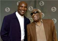 Ray Charles and Evander Holyfield at the Westin Peachtree Plaza in Atlanta, where Ray received the Heroes Award from the National Academy of Recording Arts and Sciences, on July 18th, 2002, Photo by R. Diamond/Getty.