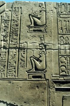 Woman in birthing chair: various medical instruments on right. Limestone relief Kawm Umbu (Kom Ombo).