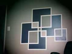 After painting a wall the color you want, tape it off in a design you want using frog tape. In my case I did a bunch of squares. Paint them the colors you want allow to dry for 24 hours, remove tape slowing to ensure you don't peel the paint and voila! you have magnificent and unique feature wall!