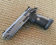 A Metrillo build STI 2011 USPSA Limited division master piece. The gun features a custom machine lower grip, higher capacity mags, a tungsten sleeved barrel and one of the slickest slide to frame fit I have ever seen. At it's definitely expensive Weapons Guns, Airsoft Guns, Guns And Ammo, Custom 1911, Custom Guns, Tactical Knives, Tactical Gear, 1911 Pistol, Tac Gear
