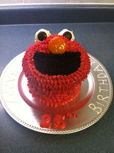 Giant cupcake decorated like Elmo. Butter pecan cake with cream cheese icing and added food colouring