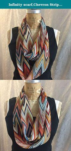 "Infinity scarf,Chevron Stripe, Large Zig Zag Stripe Pattern, Blue, Black, Taupe,Rust,Orange. Semi Sheer Polyester Chiffon. Handmade in USA. This handmade infinity scarf is made from polyester chiffon. This is a Chevron Zig Zag Stripe pattern. Colors are blue, black, orange, rust, taupe. Measurements are 9"" x 68""."