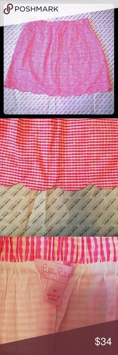 Lilly Pulitzer Neon Pink Gingham Checkered Skirt Never worn. In like-new condition! Has pockets, elastic waist around the back and a scalloped bottom hem. Lilly Pulitzer Skirts