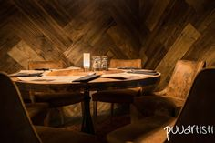 Restaurant tables and wooden interior from 100+ year old reclaimed wood. Restaurant Local Bistro. Woodwork by Puuartisti. Interior design by Nurkanvaltaajat.