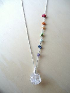 This 7 Chakra necklace was created to aid in balancing . A single raw clear quartz remains the focal piece of this necklace with 7 chakra chip bead stones lining the side of its chain. The quartz has been added to energize the other stones. Ruby Jewelry, Crystal Jewelry, Crystal Necklace, Wire Jewelry, Gemstone Jewelry, Beaded Jewelry, Jewelery, Quartz Necklace, Chakra Necklace
