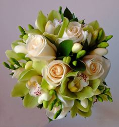 ivory roses green orchids and freesia wedding flower bridal party bouquet