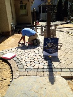 Poolside and sidewalk in progress.  Small stones are TechoBloc Antika, larger square and rectangle stones are TechoBloc Athena.