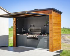 An outdoor kitchen is an ideal addition to your garden if you enjoy cooking outdoors and want to upgrade from a BBQ Small Outdoor Kitchens, Outdoor Kitchen Grill, Outdoor Cooking Area, Outdoor Kitchen Design, Small Garden Kitchen, Outdoor Sinks, Outdoor Showers, Outdoor Grill Station, Outdoor Bar And Grill