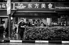 During my walk at chinatown, was raining at that time, saw a man standing with his phone behind a chinese restaurant, the composition was nice when i saw this frame, and just about the perfect time. Clicked!