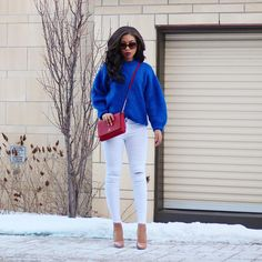 winter outfit inspiration- fall outfit inspiration - street style - street chic style - casual outfits - statement sweater - royal blue sweater outfit - white skinny jeans - white denim outfit - nude pumps - christian louboutin - bright sweater outfit - oversized sweater - pigalle plato 120 - kate spade bag - amynicolaox