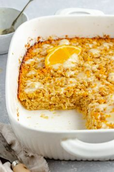 Gorgeous orange baked oatmeal that tastes just like an orange creamsicle! This bright and fresh orange baked oatmeal is naturally sweetened with a bit of pure maple syrup and has wonderful hints of fresh orange juice and zest in every bite. Drizzle with a little orange yogurt topping or add some fun flavor mix-ins for the perfect brunch treat! #bakedoatmeal #oatmeal #brunch #orange #breakfast #healthybreakfast #glutenfree