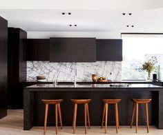 """Custom black-stained American oak kitchen **joinery** by [DSK Kitchens + Furniture](http://www.dsk.net.au/?utm_campaign=supplier/