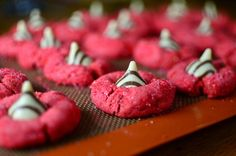 The over-the-top joconde got me hooked on the color hot pink, and I have a thing for anything chocolate/peanut butter. Behold a hot pink, Hugs-version of the classic Peanut Butter Kiss cookie. Thes...