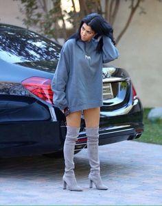 Kourtney Kardashian in Yeezy hoody and Stuart Weitzman boots