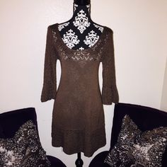 FREE PEOPLECHOCOLATE KNIT BOHO MINI Chocolate knit 3/4 bell sleeve dress. Excellent condition. Worn 3 times. Super cute for Fall with over the knee boots. Runs a little small. Is a SZ large but fits more like a medium. All offers considered Free People Dresses Mini