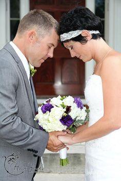 Bride and groom praying Heidi Burks Photography