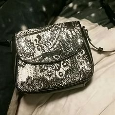 Vera Bradley purse. Cute sequence black and white purse. Perfect for going out. Never used. Has 3card slots and a pocket of the back that can fit a phone. Adjustable strap Vera Bradley Bags Crossbody Bags