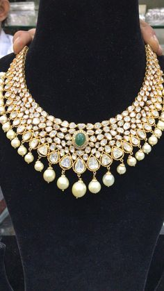 Beautiful gold necklace studded with flat diamonds and emeralds. Necklace with pearl hangings. 91.6 KDM HALLMARK GOLD FLAT DIAMONDS . 14 May 2018