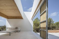 Ca l'Amo - Marià Castelló · Architecture Tiny House, Hotel Ibiza, Wooded Landscaping, Modern Minimalist House, Dry Stone, Exterior, White Paneling, Built In Storage, Sliding Glass Door