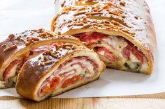 This meat- and cheese-stuffed stromboli will feed a crowd! Ham, salami, provolone, and mozzarella get rolled up in pizza dough. Easy to make, easy to share.