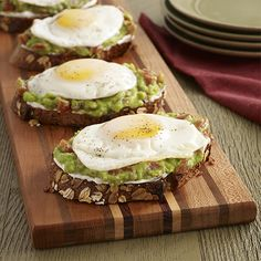 Spicy Avocado Toast with Egg: A vegetarian toast recipe of cream cheese on whole grain bread topped with mashed avocado and zesty tomatoes and an egg
