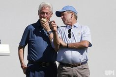 Former U.S. Presidents Bill Clinton and George Bush watch the action from the first tee box on day one of the Presidents Cup on September…