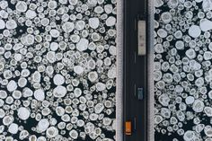 A lorry and cars travel on a road over the ice-covered Vistula river near the village of Kiezmark. Photographer Kacper Kowalski took this image from a paraglider  Photograph: Kacper Kowalski/Panos