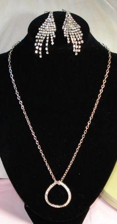 Rhinestone Pendant Necklace & Cascading by AAAJEWELRYSTORE on Etsy, $25.00 https://www.etsy.com/listing/187651955/rhinestone-pendant-necklace-cascading