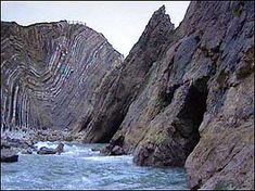 UK. Dorset Coast Geology: at Stair Hole, the rocks have been forced up & contorted into the Lulworth Crumples. Throughout the area surrounding the cove there are excellent examples of exposures of folded Jurassic/ Cretaceous rock strata, providing a continuous record of about 80 Ma of the Earth's past geography & climates