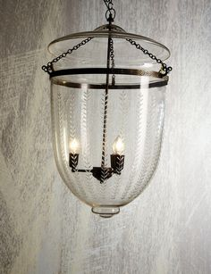 This style of pendant is perfect for entrances and there are so many options on the market. This particular one has a decorative solid brass frame (in a dark aged finish) with leaf patterned glass. 460mm wide $799
