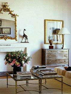 Sometimes all one needs is a great pair of antique gold coffee tables, a fabulous bouquet of fresh flowers and gorgeous books! And that someone is Lee Radziwill.   leeradzawillapt