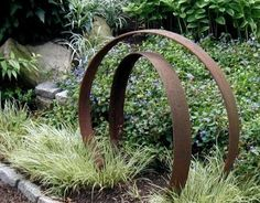 an Inviting Outdoor Conversation Area big iron circles for garden. Decayed whiskey barrel planter is garden sculpture.big iron circles for garden. Decayed whiskey barrel planter is garden sculpture.