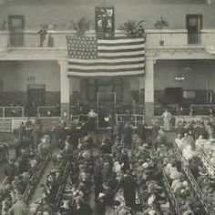 View of the new arrivals in the Central Hall, Ellis Island (1896)