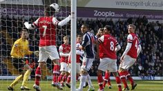 Arsenals Tomas Rosicky (2nd L) heads the ball off the goal line. He also helps the #Gunners with his brace.