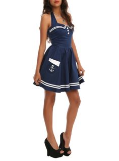 Navy 50s-inspired halter dress featuring a nautical theme with white stripe trim.