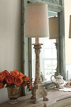 Candlestick Buffet Lamp Tall and narrow, this buffet lamp looks lovely in pairs on a buffet, mantel or console. Inspired by after an antique candlestick, the carved wood base