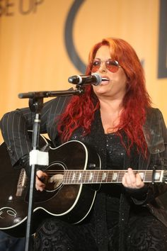 Wynonna performs at the CMA Close Up Stage at AT U-Verse Fan Fair X in Downtown Nashville on Friday, June 7 during the 2013 CMA Music Festival. Photo courtesy of the CMA., 2013