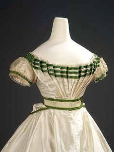 In the Swan's Shadow: Girl's formal evening dress with sash, 1867 It's also a House of Worth. Girl's formal evening dress with sash Charles Frederick Worth (1825 - 1895) Silk taffeta trimmed with bands of bright green silk satin, white silk lace and sheer silk tabby net 1867