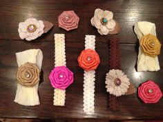 """Made these interchangeable headbands for baby girl. Each headband and flower has a snap on it so I can change out each flower to go on any headband. They are """"semi-homemade"""" as I bought the flowers and headbands from Hobby Lobby and just sewed on the snaps. You could obviously make the flowers yourself. Each headband ended up costing about $0.65 each- way cheaper than Etsy!!"""