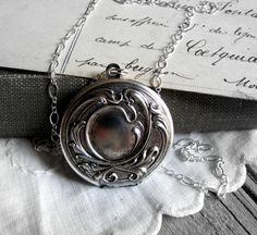 Round Silver Locket Sterling Silver Necklace Photo by TwigsAndLace