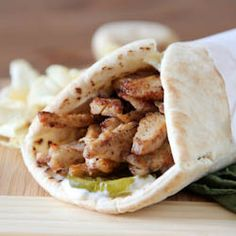 Tender spiced chicken strips layered with tangy pickles and mayonnaise on soft pita bread to create a delicious Middle-Eastern wrap.