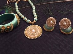 Subtle and beautiful handcrafted light green silk thread set with white stone accents! The thick bangle with gorgeous accent is the finishing touch to this set! Included: 1 Necklace (adjustable length) 2 Earrings Bangles as shown Approximate dimensions (inches): Necklace pendant