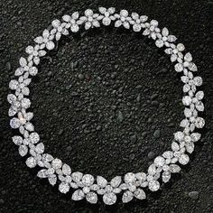 A magnificent diamond 'Holly Wreath' necklace set with 152ct of pear-shape, round and marquise diamonds by Harry Winston
