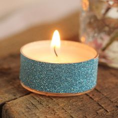 30-Second Glitter Tea Lights, I'm thinking double sided tape and glitter. Super fast and you can get double sided tape at the dollar store.
