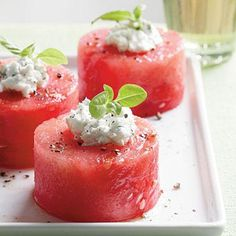 Herbed Goat Cheese-Melon Party Bites | Indulge in the warm days of summer with this refreshing watermelon and goat cheese combination. | #Recipes | SouthernLiving.com