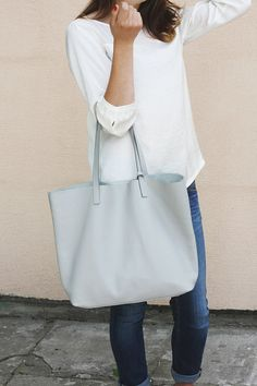 This gray leather tote is perfect for everyday as well as for travel!  Made from high quality pebbled Italian leather, the bag is soft and slouchy.