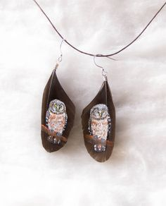 hand painted owl feather earrings by hoyhenenkevytta on Etsy
